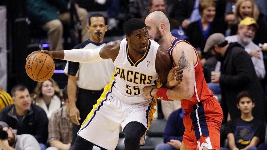 Indiana Pacers center Roy Hibbert, left, looks to go around Washington Wizards center Marcin Gortat, of Poland, during the first half of an NBA basketball game in Indianapolis, Friday, Jan. 10, 2014. (AP Photo/AJ Mast)