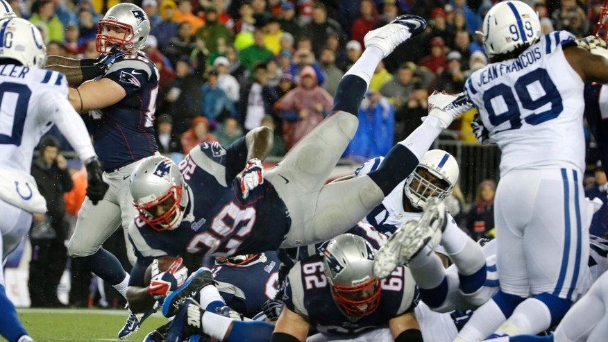 New England Patriots running back LeGarrette Blount (29) dives into the end zone for a touchdown during the first half of an AFC divisional NFL playoff football game against the Indianapolis Colts in Foxborough, Mass., Saturday, Jan. 11, 2014. (AP Photo/Matt Slocum)