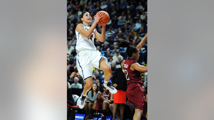 Connecticut's Bria Hartley (14) drives to the basket past Temple's Feyonda Fitzgerald (2) during the first half of an NCAA college basketball game in Bridgeport, Conn., Saturday,  Jan. 11, 2014. (AP Photo/Fred Beckham)