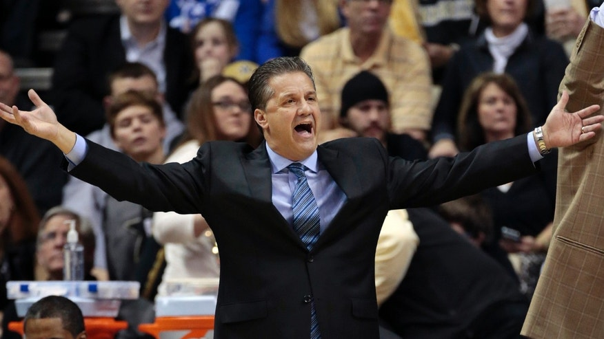 Kentucky coach John Calipari yells to an official during the first half of an NCAA college basketball game against Vanderbilt on Saturday, Jan. 11, 2014, in Nashville, Tenn. (AP Photo/Mark Humphrey)