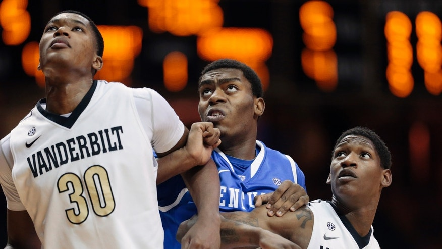 Kentucky's Dakari Johnson, center, works for position between Vanderbilt's Damian Jones (30) and Dai-Jon Parker for a rebound during the first half of an NCAA college basketball game Saturday, Jan. 11, 2014, in Nashville, Tenn. (AP Photo/Mark Humphrey)