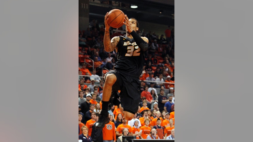 Missouri's Jabari Brown puts up a layup during the first half of an NCAA college basketball game against Auburn on Saturday, Jan. 11, 2014, in Auburn, Ala. (AP Photo/Butch Dill)