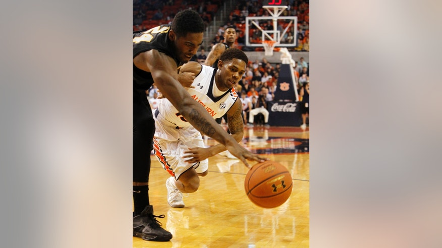 Missouri's Torren Jones, left, and Auburn's Tahj Shamsid-Deen scramble for a loose ball during the first half of an NCAA college basketball game on Saturday, Jan. 11, 2014, in Auburn, Ala. (AP Photo/Butch Dill)