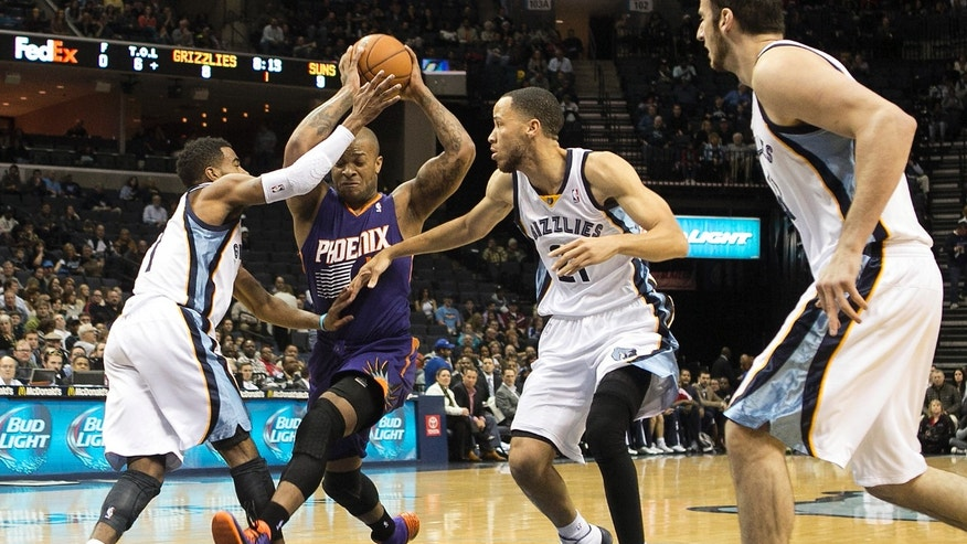 Phoenix Suns forward P.J. Tucker, second from left, goes to the basket against Memphis Grizzlies guard Mike Conley (11), forward Tayshaun Prince (21) and center Kosta Koufos (41) in the first half of an NBA basketball game, Friday, Jan. 10, 2014, in Memphis, Tenn. (AP Photo/Lance Murphey)