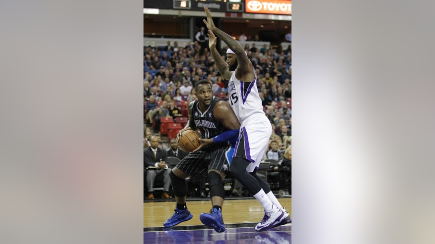 Orlando Magic center Glen Davis, left, goes to the basket against Sacramento Kings center DeMarcus Cousins during the first quarter of an NBA basketball game in Sacramento, Calif., Friday, Jan. 10, 2014. (AP Photo/Rich Pedroncelli)