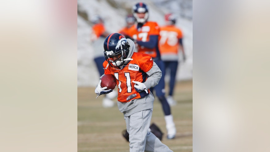 Denver Broncos wide receiver Trindon Holliday (11) pulls in a pass during practice for the football team's NFL playoff game against the San Diego Chargers at the Broncos training facility in Englewood, Colo., on Friday, Jan. 10, 2014. Special teams has turned into the Broncos' bugaboo with at least one major mistake in each of the last six games, and Trindon Holliday has had six muffs in the last two months. He also entered last year's playoffs in a prolonged slump and promptly became the first player in league history to return both a punt and a kickoff for touchdowns in the postseason.(AP Photo/Ed Andrieski)