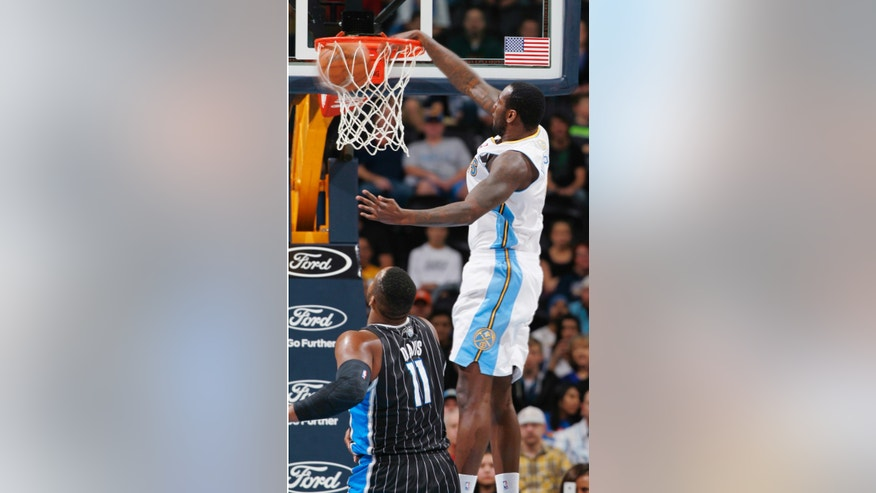 Denver Nuggets forward J.J. Hickson, right, dunks ball over Orlando Magic center Glen Davis in the first quarter of an NBA basketball game in Denver on Saturday, Jan. 11, 2014. (AP Photo/David Zalubowski)