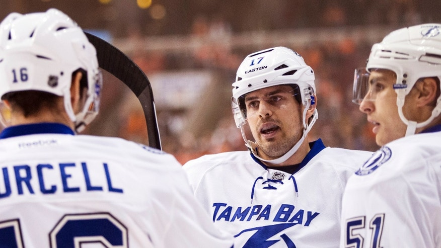 Tampa Bay Lightning's Alex Killorn, center, celebrates his goal with Teddy Purcell, left, and Valtteri Filppula, right, of Finland, during the first period of an NHL hockey game against the Philadelphia Flyers, Saturday, Jan. 11, 2014, in Philadelphia. (AP Photo/Chris Szagola)