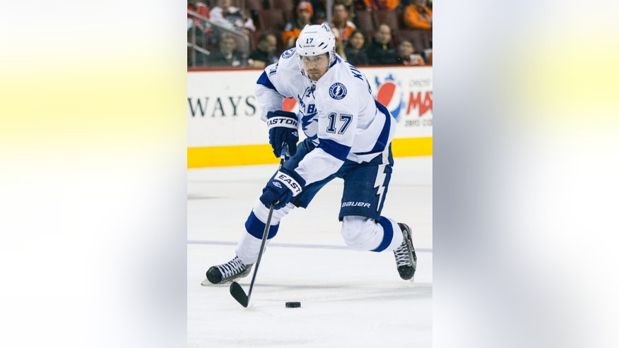 Tampa Bay Lightning's Alex Killorn skates the puck into the zone during the first period of an NHL hockey game against the Philadelphia Flyers, Saturday, Jan. 11, 2014, in Philadelphia. (AP Photo/Chris Szagola)