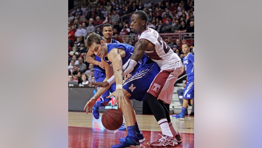 Memphis' Austin Nichols, left and Temple's Quenton DeCosey chase a loose ball in the first half of an NCAA basketball game, Saturday, Jan. 11, 2014, in Philadelphia. (AP Photo/H. Rumph Jr.)