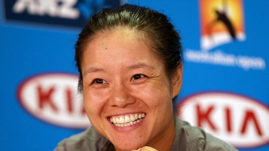 China's Li Na answers a question during a news conference ahead of the Australian Open tennis championship in Melbourne Australia, Saturday, Jan. 11, 2014. (AP Photo/Aaron Favila)