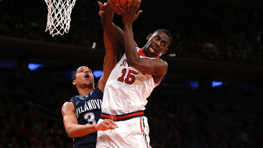St. John's Sir'Dominic Pointer (15) grabs a rebound against Villanova's Josh Hart (3) during the first half of an NCAA college basketball game Saturday, Jan. 11, 2014, in New York. (AP Photo/Jason DeCrow)
