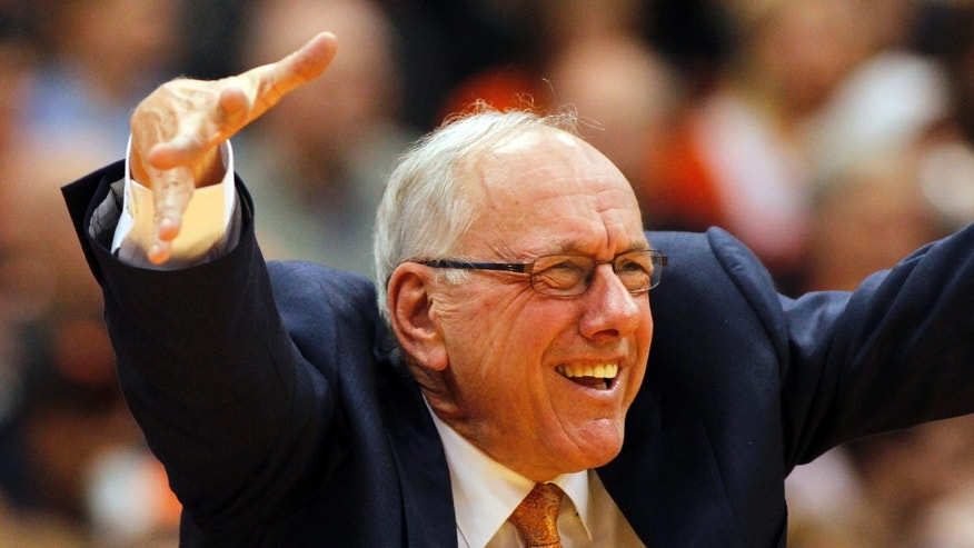 Syracuse head coach Jim Boeheim calls out to his players in the second half of an NCAA college basketball game against North Carolina in Syracuse, N.Y., Saturday, Jan. 11, 2014. Syracuse won 57-45. (AP Photo/Nick Lisi)