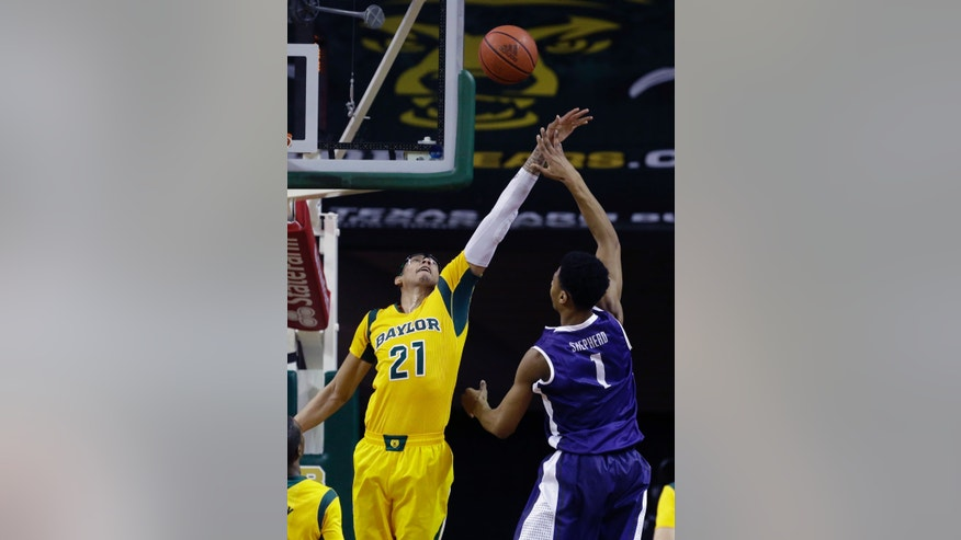 TCU center Karviar Shepherd (1) shoots against Baylor center Isaiah Austin (21) during the first half of an NCAA college basketball game Saturday, Jan. 11, 2014, in Waco, Texas. (AP Photo/LM Otero)