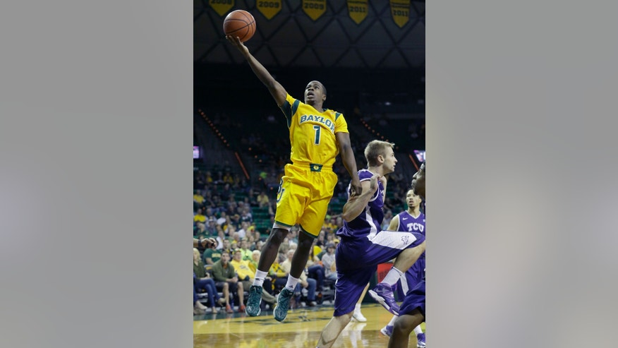 Baylor guard Kenny Chery (1) makes a layup against TCU guard Christian Gore during the first half of an NCAA college basketball game Saturday, Jan. 11, 2014, in Waco, Texas. (AP Photo/LM Otero)