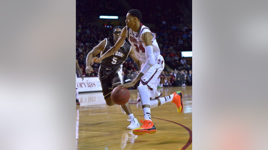 UMass' Raphiael Putney moves in past St. Bonaventure's Jordan Gathers during an NCAA college basketball game on Saturday, Jan. 11. 2014 in Amherst, Mass.    (AP Photo/The Republican, Michael Beswick)