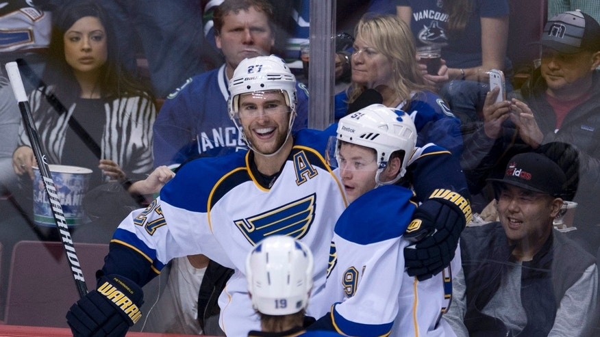 St. Louis Blues defenseman Alex Pietrangelo (27) celebrates his goal with teammates Vladimir Tarasenko (91) and Jay Bouwmeester (19) during the second period of an NHL hockey game Friday, Jan. 10, 2014, in Vancouver, British Columbia. (AP Photo/The Canadian Press, Jonathan Hayward)
