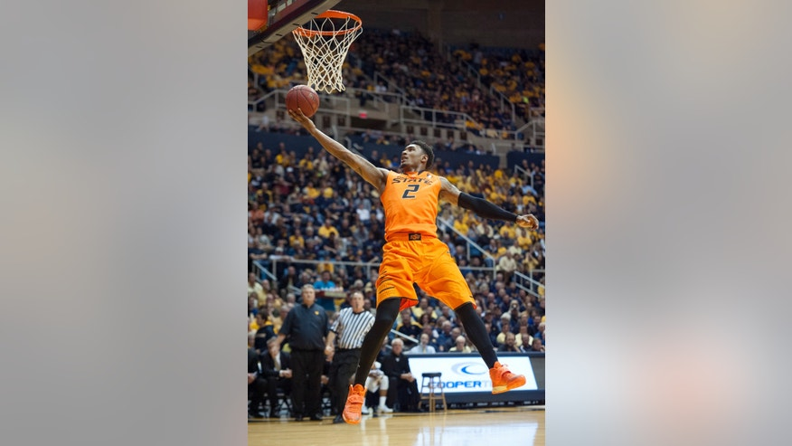 Oklahoma State's Le'Bryan Nash (2) drives to the basket during the first half of an NCAA college basketball game against West Virginia, Saturday, Jan. 11, 2014, in Morgantown, W.Va. (AP Photo/Andrew Ferguson)