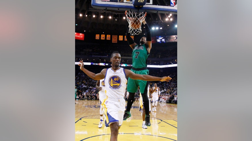 Boston Celtics' Jared Sullinger (7) dunks next to Golden State Warriors' Harrison Barnes (40) during the first half of an NBA basketball game Friday, Jan. 10, 2014, in Oakland, Calif. (AP Photo/Marcio Jose Sanchez)