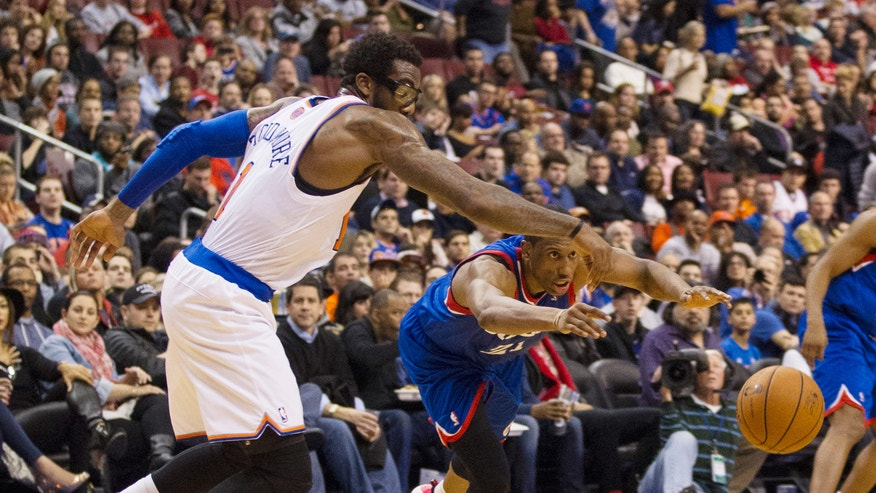 New York Knicks' Amar'e Stoudemire, left,, reaches for the ball after Philadelphia 76ers' Thaddeus Young, right, knocked it away from him during the first half of an NBA basketball game, Saturday, Jan. 11, 2014, in Philadelphia.  (AP Photo/Chris Szagola)