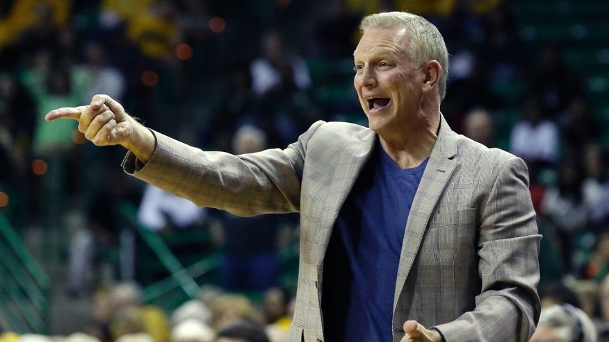 TCU head coach Jeff Mittie yells from the sideline during the first half of an NCAA college basketball game against Baylor, Saturday, Jan. 11, 2014, in Waco, Texas. (AP Photo/LM Otero)