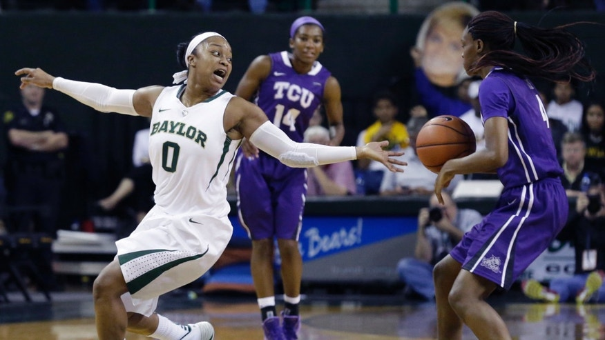 Baylor guard Odyssey Sims (0) reaches for the ball against TCU forward Chelsea Prince, right, as guard Zahna Medley (14) looks on during the first half of an NCAA college basketball game, Saturday, Jan. 11, 2014, in Waco, Texas. (AP Photo/LM Otero)