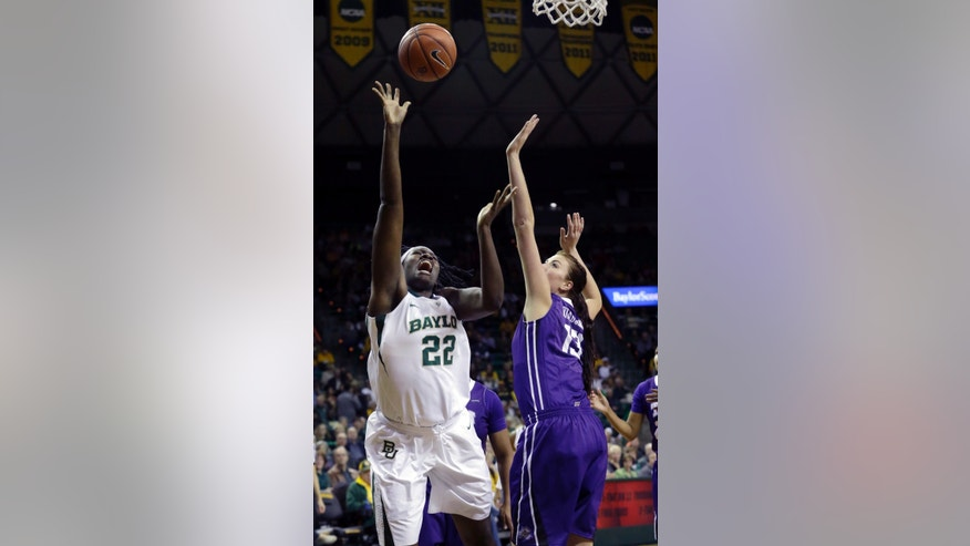 Baylor center Sune Agbuke (22) shoots against TCU center Klara Bradshaw, right, during the first half of an NCAA college basketball game, Saturday, Jan. 11, 2014, in Waco, Texas. (AP Photo/LM Otero)