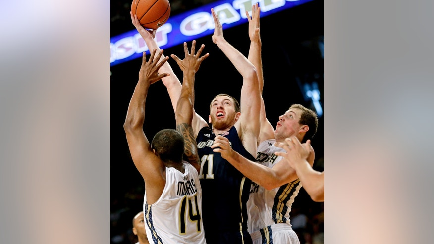 Notre Dame's Garrick Sherman, center, puts up a shot against Georgia Tech's Jason Morris, left, and Daniel Miller, right, in the first half of an NCAA college basketball game, Saturday, Jan. 11, 2014, in Atlanta. (AP Photo/David Goldman)