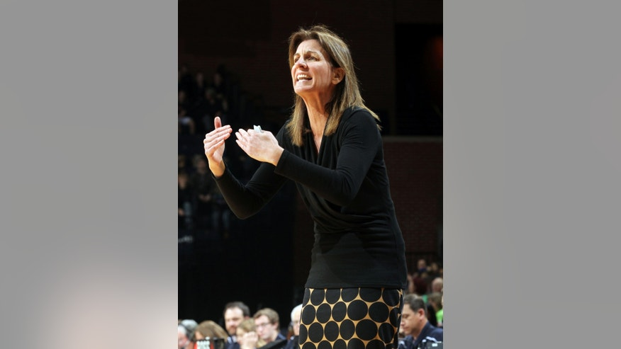 Virginia head coach Joanne Boyle reacts to a call during the first half of an NCAA basketball game against Notre Dame Sunday Jan. 12, 2014 in Charlottesville, Va. (AP Photo/Andrew Shurtleff)