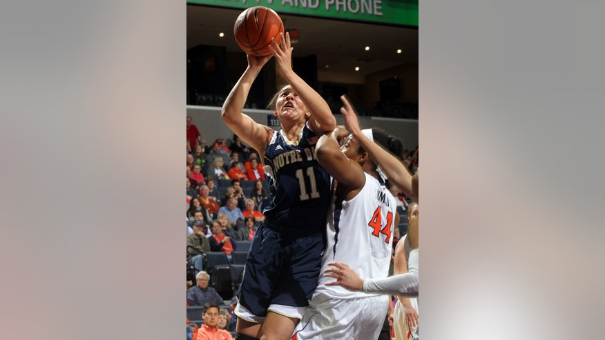 Notre Dame forward Natalie Achonwa (11) shoots next to Virginia forward Sydney Umeri (44) during the first half of an NCAA college basketball game on Sunday, Jan. 12, 2014, in Charlottesville, Va. (AP Photo/Andrew Shurtleff)