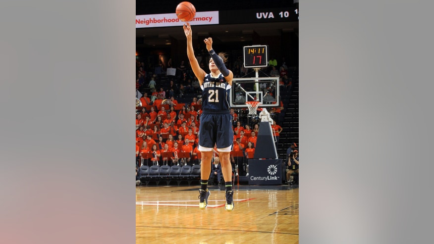 Notre Dame guard Kayla McBride (21) shoots a three point shot during the first half of an NCAA basketball game against Virginia Sunday Jan. 12, 2014 in Charlottesville, Va. (AP Photo/Andrew Shurtleff)