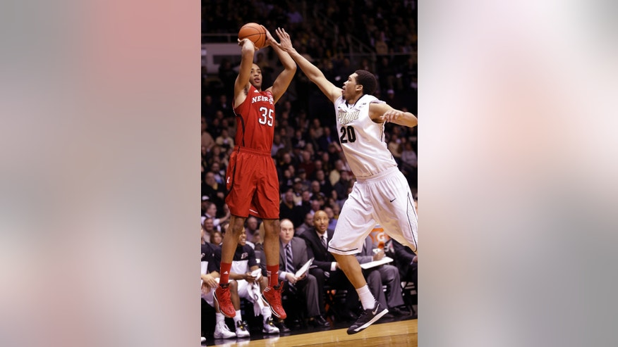 Nebraska forward Walter Pitchford, left, shoot over Purdue center A.J. Hammons in the first half of an NCAA college basketball game in West Lafayette, Ind., Sunday, Jan. 12, 2014.  (AP Photo/Michael Conroy)