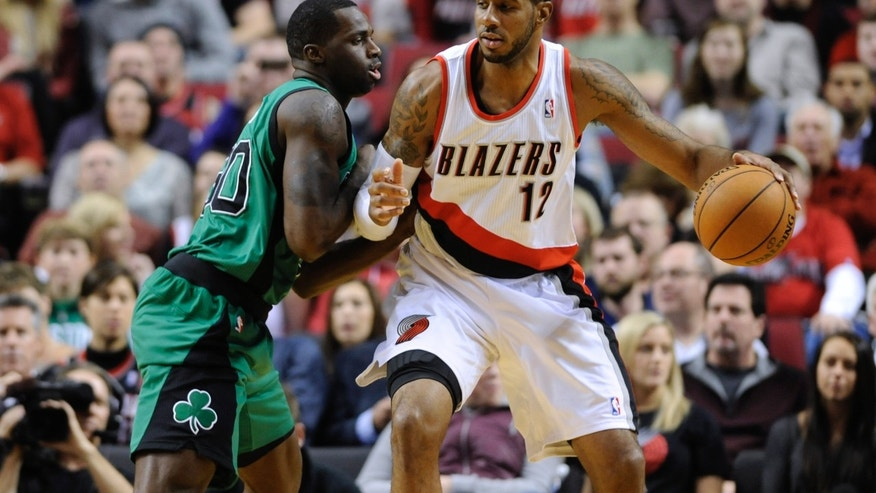 Boston Celtics' Brandon Bass (30) defends against Portland Trail Blazers' LaMarcus Aldridge (12) during the first half of an NBA basketball game in Portland, Ore., Saturday, Jan. 11, 2014. (AP Photo/Greg Wahl-Stephens)