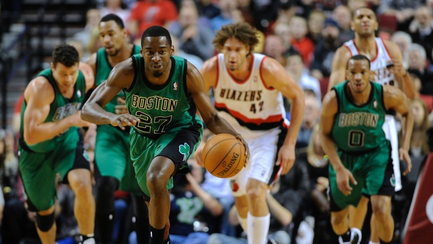 Boston Celtics' Jordan Crawford (27) runs against Portland Trail Blazers after a steal during the first half of an NBA basketball game in Portland, Ore., Saturday, Jan. 11, 2014. (AP Photo/Greg Wahl-Stephens)