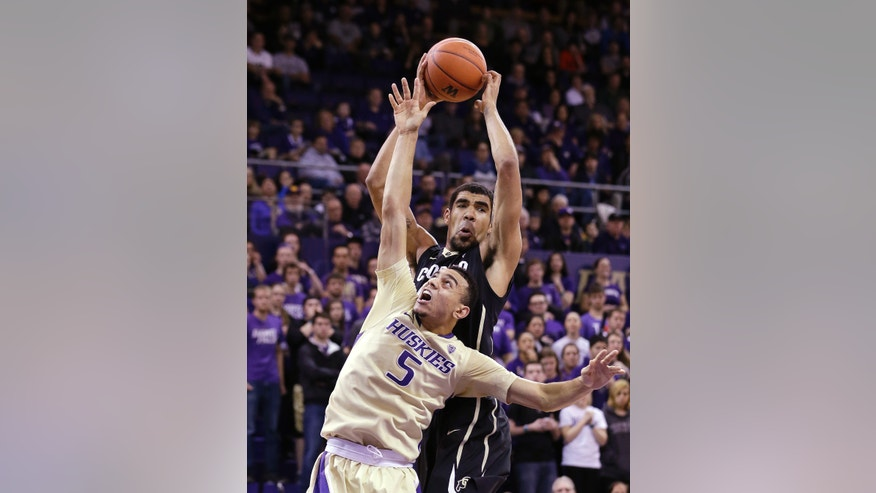 Washington's Nigel Williams-Goss (5) falls short of a rebound to Colorado's Josh Scott in the first half of an NCAA men's basketball game Sunday, Jan. 12, 2014, in Seattle. (AP Photo/Elaine Thompson)