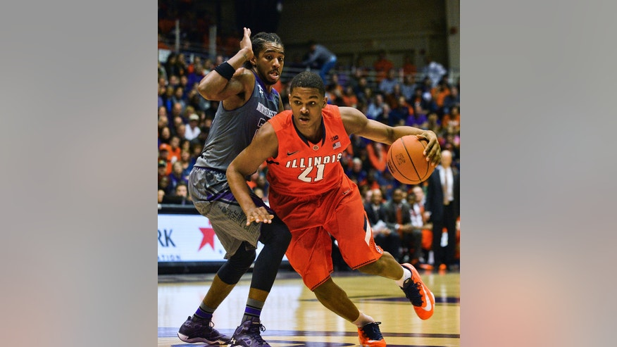 Illinois' Malcolm Hill (21) dribbles against Northwestern's JerShon Cobb (23) during the first half of an NCAA college basketball game in Evanston, Ill., on Sunday, Jan. 12, 2014. (AP Photo/Matt Marton)
