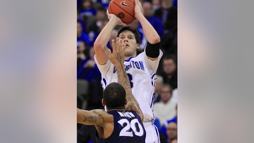 Creighton's Doug McDermott (3) shoots over Xavier's Justin Martin (20) in the first half of an NCAA college basketball game in Omaha, Neb., Sunday, Jan. 12, 2014. (AP Photo/Nati Harnik)