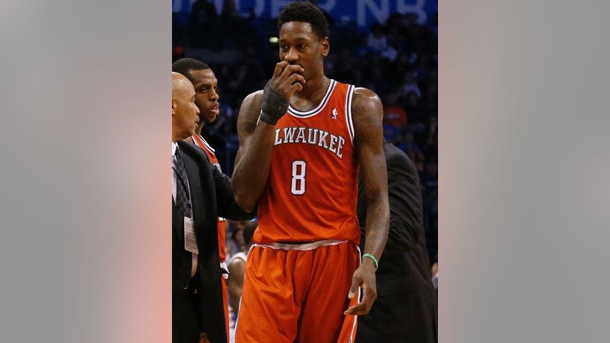 Milwaukee Bucks center Larry Sanders (8) walks off the court after a flagrant foul and ejection in the second quarter of an NBA basketball game against the Oklahoma City Thunder in Oklahoma City, Saturday, Jan. 11, 2014. (AP Photo/Sue Ogrocki)