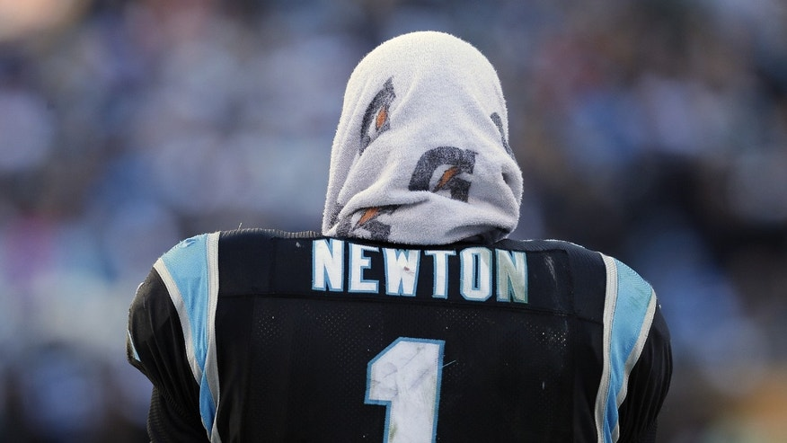 Carolina Panthers quarterback Cam Newton (1) watches play from the sidelines against the San Francisco 49ers during the second half of a divisional playoff NFL football game, Sunday, Jan. 12, 2014, in Charlotte, N.C. (AP Photo/Chuck Burton)
