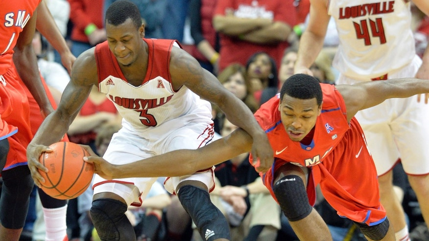 SMU's Sterling Brown, left, attempts to steal the ball away from Louisville's Chris Jones during the first half of an NCAA college basketball game on Sunday, Jan. 12, 2014, in Louisville, Ky. (AP Photo/Timothy D. Easley)