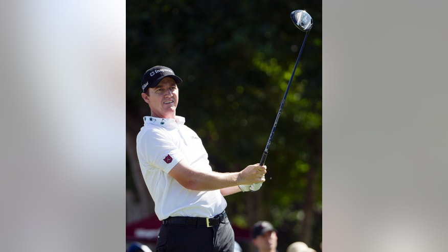 Jimmy Walker watches his drive off the first tee during the fourth round of the Sony Open golf tournament at Waialae Country Club, Sunday, Jan. 12, 2014, in Honolulu. (AP Photo/Eugene Tanner)