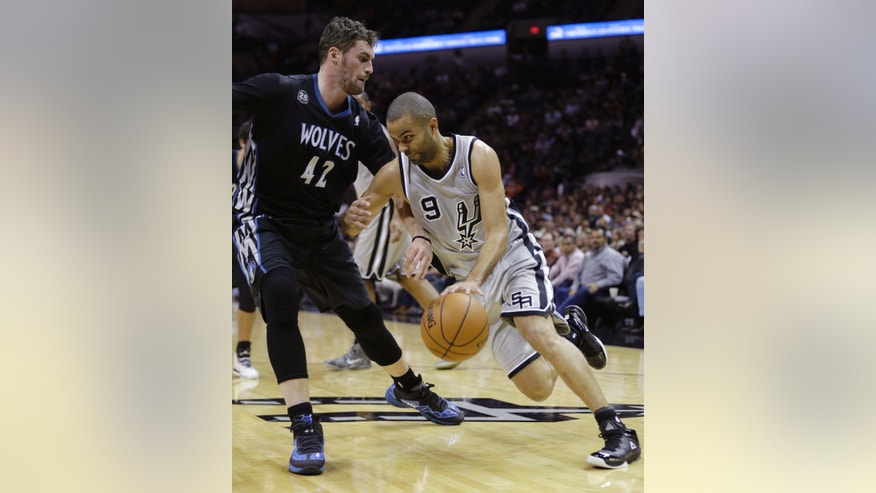 San Antonio Spurs' Tony Parker (9), of France, drives around Minnesota Timberwolves' Kevin Love (42) during the first half on an NBA basketball game, Sunday, Jan. 12, 2014, in San Antonio.  (AP Photo/Eric Gay)