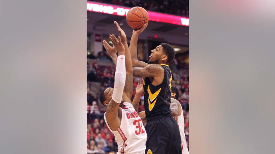 Iowa's Roy Devyn Marble, right, shoots over Ohio State's Lenzelle Smith during the first half of an NCAA college basketball game on Sunday, Jan. 12, 2014, in Columbus, Ohio. (AP Photo/Jay LaPrete)