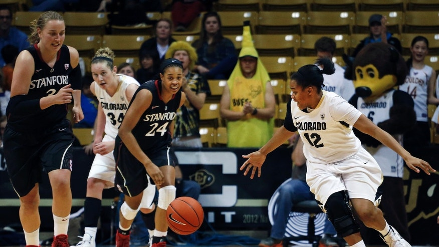 Colorado's Ashley Wilson, right, drives with the ball, pursued by Stanford's Mikaela Ruef, far left, and Erica McCall, during the second half of an NCAA college basketball game, in Boulder, Colo., Sunday, Jan. 12, 2014. Stanford won 87-77. (AP Photo/Brennan Linsley)