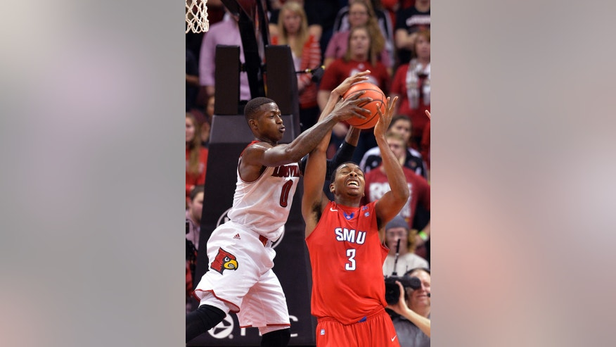 Louisville's Terry Rozier, left, battles SMU's Sterling Brown for a reboud during the second half of an NCAA college basketball game Sunday Jan. 12, 2014, in Louisville, Ky. Louisville defeated SMU 71-63. (AP Photo/Timothy D. Easley)