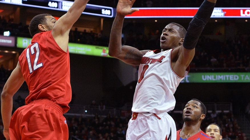 Louisville's Terry Rozier, right, puts up a shot over the defense of SMU's Nick Russell during the second half of an NCAA college basketball game Sunday Jan. 12, 2014, in Louisville, Ky. Louisville defeated SMU 71-63. (AP Photo/Timothy D. Easley)