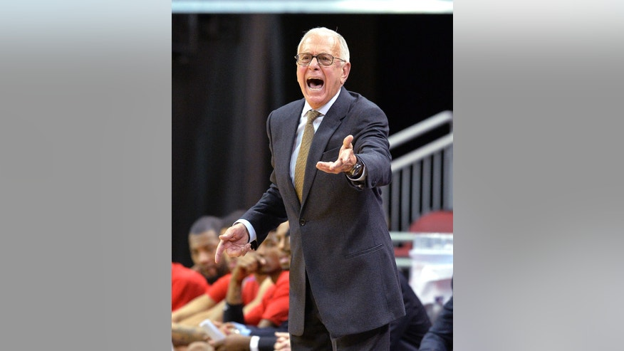 CORRECTS DAY TO SUNDAY - SMU head coach Larry Brown shouts instructions to his team during the second half of an NCAA college basketball game Sunday Jan. 12, 2014, in Louisville, Ky. Louisville defeated SMU 71-63. (AP Photo/Timothy D. Easley)