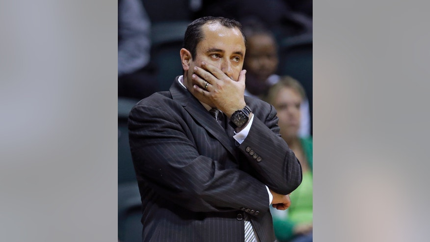 South Florida head coach Jose Fernandez reacts during the first half of an NCAA college basketball game against Louisville, Sunday, Jan. 12, 2014, in Tampa, Fla. Louisville won the game 62-54. (AP Photo/Chris O'Meara)