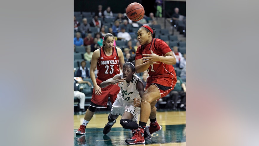 South Florida forward Alisia Jenkins, center,  knocks the ball away from Louisville forward Emmonnie Henderson, right, as guard Shoni Schimmel (23) looks on during the second half of an NCAA college basketball game, Sunday, Jan. 12, 2014, in Tampa, Fla. Louisville won 62-54.(AP Photo/Chris O'Meara)