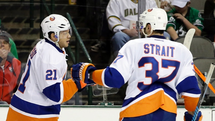 New York Islanders right wing Kyle Okposo (21) is congratulated on his goal against the Dallas Stars by Brian Strait (37) in the second period of an NHL hockey game, Sunday, Jan. 12, 2014, in Dallas. (AP Photo/Tony Gutierrez)